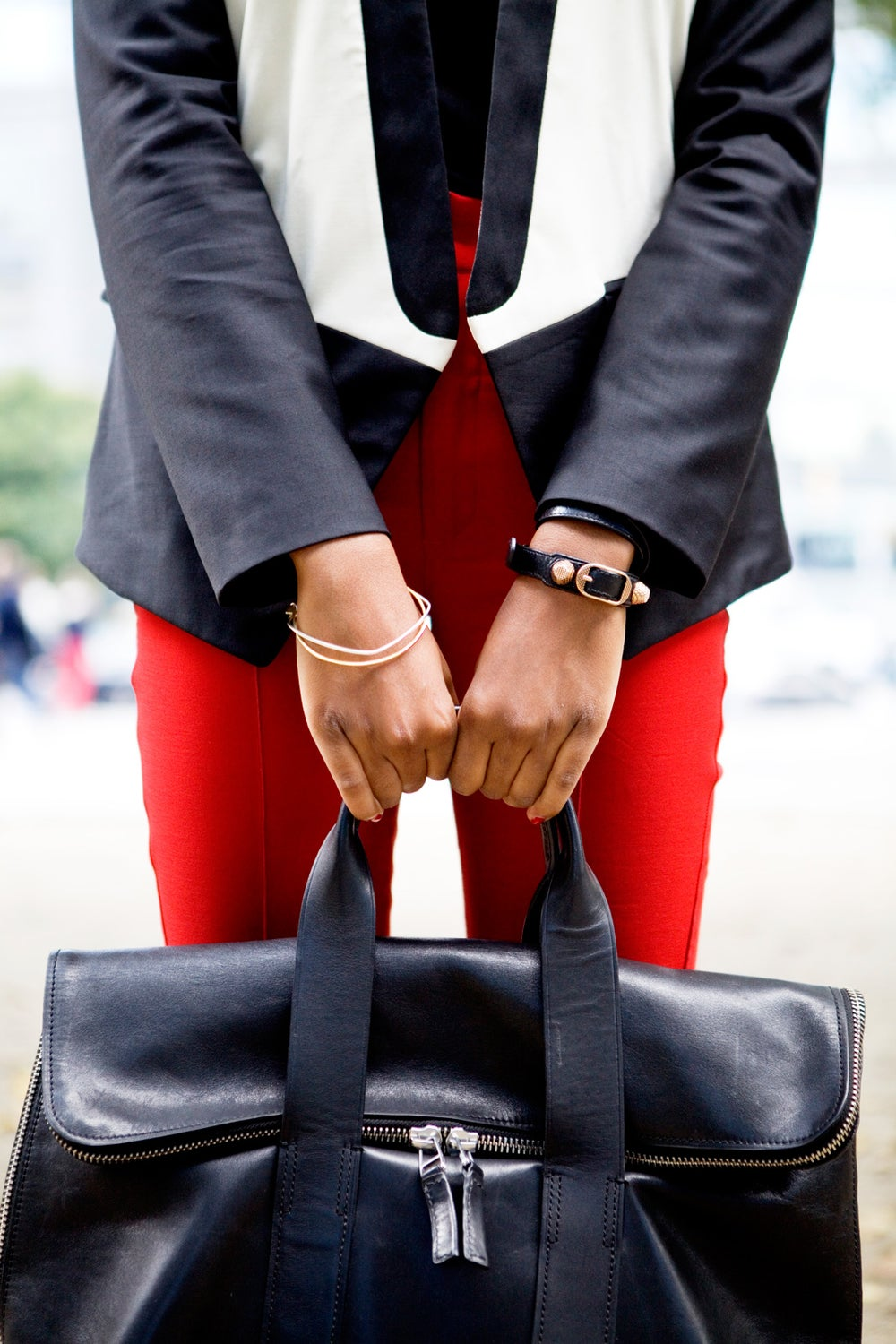 Check out that 3.1 Phillip Lim 31 Hour bag. Chrissy wears Balenciaga and Surface to Air bracelets.