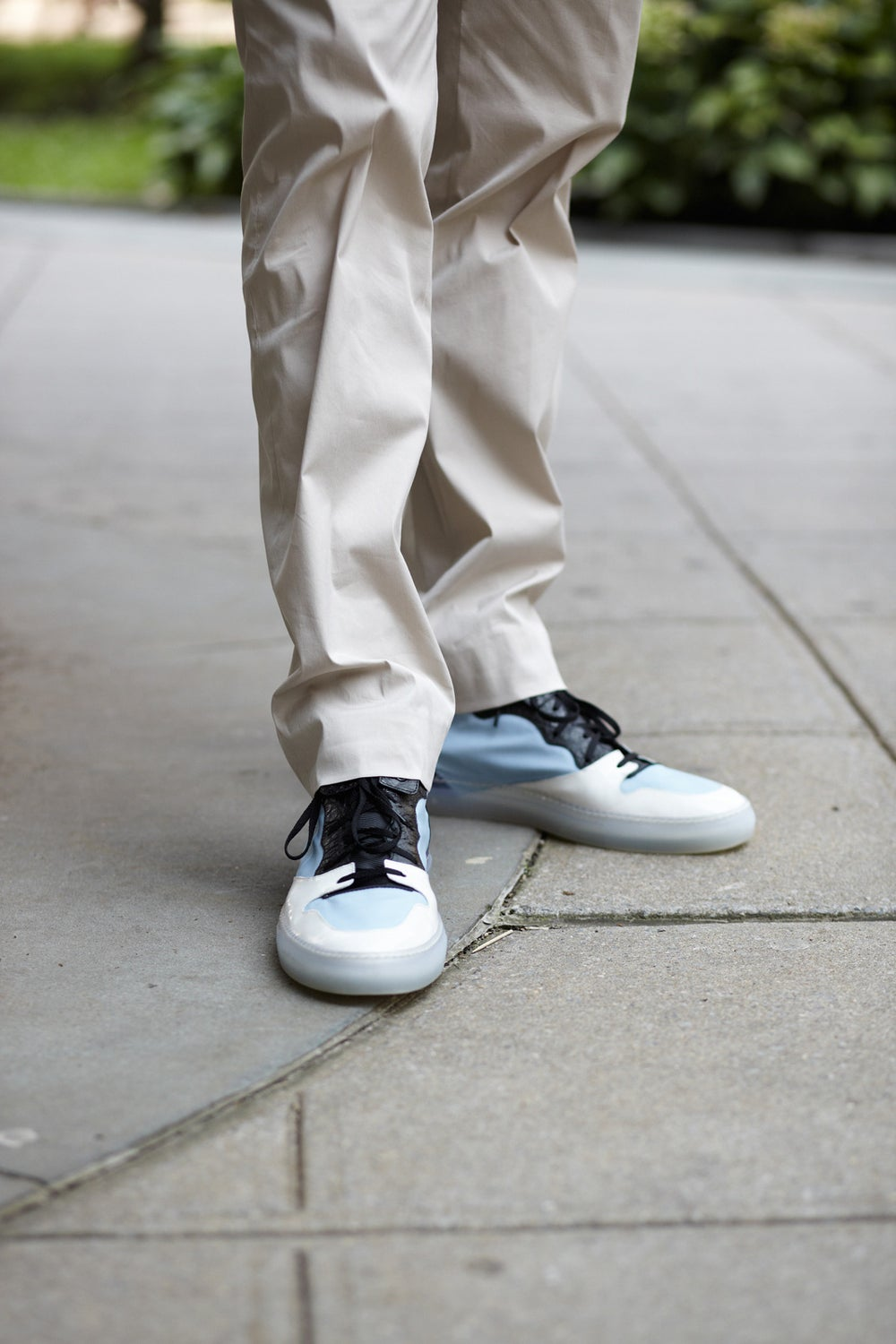 Kevin's Balenciaga sneakers aren't half-bad either.