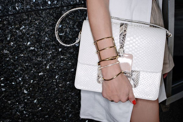 A closer look at the Devi Kroell bag. Palermo pairs it with an Elizabeth and James cuffs and a Cartier watch.